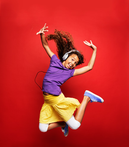 smiling child jumping into the air