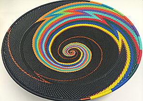 Wireless Innovation Project winners' trophy: colorful basket woven from phone wire